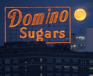 The supermoon of August 2014 competes with the Domino sign on the waterfront in Baltimore.  Photograph by Jerry Jackson of the Baltimore Sun.  http://darkroom.baltimoresun.com/2014/08/     supermoon-seen-around-the-world/#1